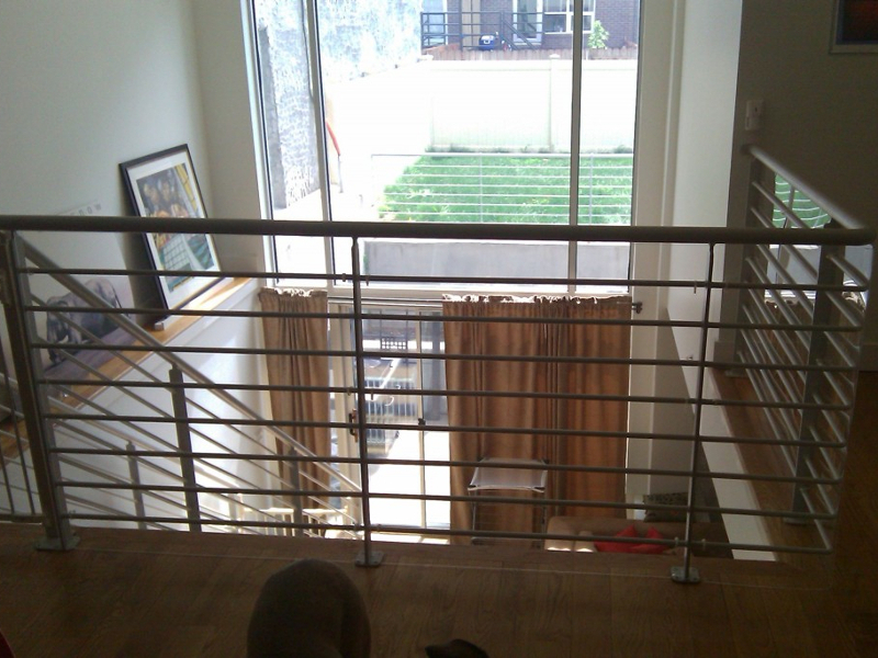 Custom acrylic stair railing cover